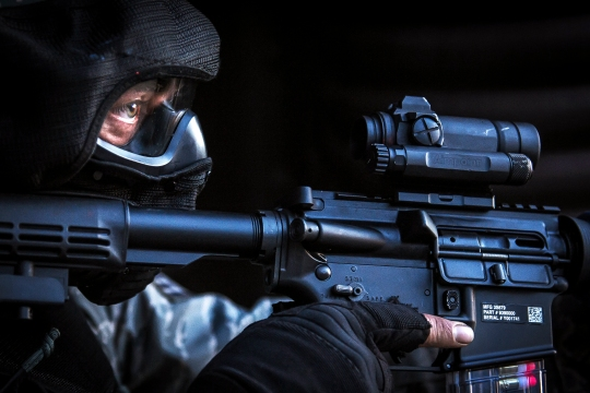 A U.S. Air Force security forces Airman secures the outside of a hardened facility after neutralizing the opposing force during a combat training course on Ramstein Air Base, Germany, May 30, 2015. Battlefield Leaders Assaulter Course, Integrated Combat Essentials -- or BLAC ICE is designed to teach security forces members from multiple countries advanced tactics and shooting skills for use in the event of a base security breach. (U.S. Air Force photo/ Tech. Sgt. Ryan Crane)