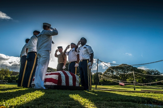 U.S. service members from the Defense POW/ MIA Accounting Agency (DPAA) render honors during a disinterment ceremony at the National Memorial Cemetery of the Pacific, Honolulu, HI June 8, 2015. The disinterments were conducted in effort to identify the U.S. service members from the U.S.S. Oklahoma buried as unknowns.  The mission of DPAA is to conduct global search, recovery and laboratory operations to provide the fullest possible accounting for our missing personnel to their families and the nation. (U.S. Marine Corps Photo by SGT. Eric M. LaClair/ released)