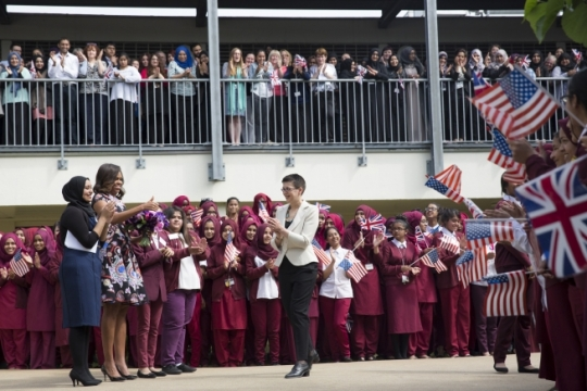 """First Lady Michelle Obama is welcomed by students at Mulberry School for Girls in London, England, June 16, 2015. The First Lady visited the school to discuss cooperation between the United States and the United Kingdom to improve educational opportunities for girls around the world through the """"Let Girls Learn"""" initiative. (Official White House Photo by Amanda Lucidon)"""