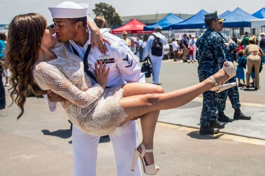 150604-N-IK388-119 SAN DIEGO (June 4, 2015) Boatswain's Mate 3rd Class Jesse Ibarra, assigned to the guided-missile cruiser USS Bunker Hill (CG 52), greets his wife during a homecoming celebration at Naval Base San Diego. The Carl Vinson Strike Group returns from a nearly 10-month deployment to the U.S. 5th and 7th Fleet areas of operations. (U.S. Navy photo by Mass Communication Specialist 2nd Class Stacy M. Atkins Ricks/Released)