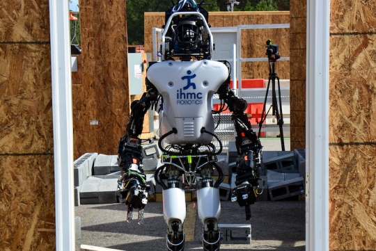 A robot awaits competition in the robotics challenge through the Defense Advanced Research Projects Agency, known as DARPA, in Pomona, Calif., June 5-6, 2015. The event requires robots to attempt a circuit of physical tasks, with degraded communications between robots and operators. Twenty-four of the top robotics organizations in the world will compete for $3.5 million in prizes. Check out the DARPA Robotic Challenge finals website at: www.theroboticschallenge.org.