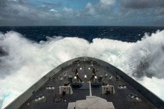 INDIAN OCEAN (June 22, 2015) San Antonio-class amphibious transport dock ship USS Anchorage (LPD 23) transits the Indian Ocean. Anchorage is part of the Essex Amphibious Ready Group and with the embarked 15th Marine Expeditionary Unit (15th MEU), is deployed in support of maritime security operations and theater security cooperation efforts in the U.S. 5th Fleet area of operations. (U.S. Navy photo by Mass Communication Specialist 2nd Class Liam Kennedy/Released)