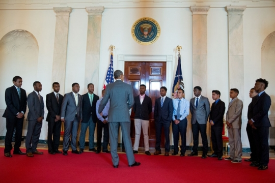 President Barack Obama talks to graduating seniors and junior mentees in the Cross Hall prior to the White House Mentorship and Leadership graduation ceremony in the Blue Room of the White House, June 15, 2015. (Official White House Photo by Pete Souza)
