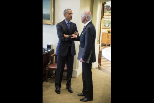 President Barack Obama talks with Vice President Joe Biden regarding the mass shooting at the Emanuel AME Church in Charleston, S.C., in the Outer Oval Office, June 18, 2015. (Official White House Photo by Pete Souza)