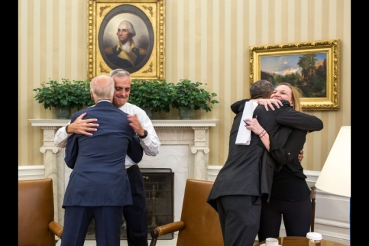 President Barack Obama hugs Kristie Canegallo, Deputy Chief of Staff, and Vice President Joe Biden hugs Chief of Staff Denis McDonough as they celebrate the Supreme Court ruling on Affordable Care Act subsidies in the Oval Office, June 25, 2015. (Official White House Photo by Pete Souza)