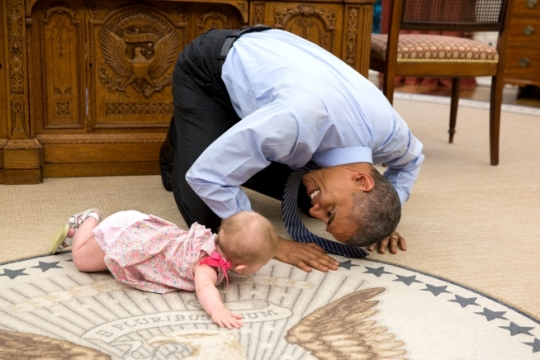 President Barack Obama plays with Ella Harper Rhodes, daughter of Ben Rhodes, Deputy National Security Advisor for Strategic Communications, during an Oval Office drop by, June 4, 2015. (Official White House Photo by Pete Souza)