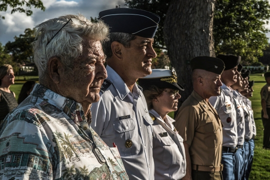 Mr. Ray Emory, Major General Kelley McKeague, Rear Admiral Kathy Creighton, and members of the Defense POW/MIA Accounting Agency (DPAA) participate in a disinterment ceremony at the National Memorial Cemetery of the Pacific, Honolulu, HI June 8, 2015. The disinterments were conducted in effort to identify the U.S. service members from the U.S.S. Oklahoma buried as unknowns.  The mission of DPAA is to conduct global search, recovery and laboratory operations to provide the fullest possible accounting for our missing personnel to their families and the nation. (U.S. Marine Corps Photo by SGT. Eric M. LaClair/ released)