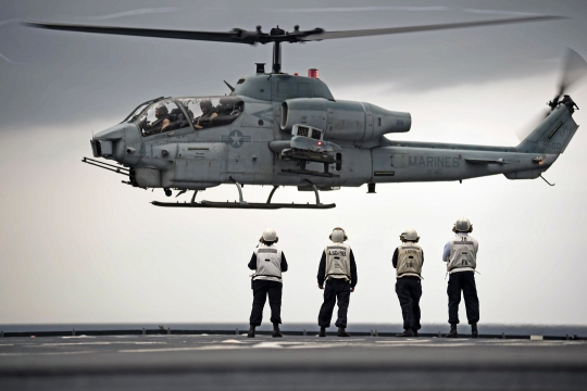 150605-N-KM939-533  PACIFIC OCEAN (June 5, 2015) An AH-1W Super Cobra attached to the 31st Marine Expeditionary Unit (31st MEU) attempts a touch and go on the flight deck of the dock landing ship USS Ashland (LSD 48) during flight quarters. Ashland, part of the Bonhomme Richard Amphibious Ready Group, is assigned to the U.S. 7th Fleet area of operations supporting security and stability in the Indo-Asia-Pacific region. (U.S. Navy photo by Mass Communications 3rd Class David A. Cox/Released)