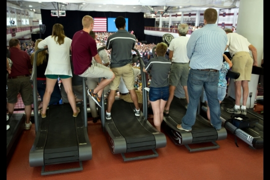 Audience members standing on treadmills listen as President Barack Obama makes remarks at the University of Wisconsin at La Crosse in La Crosse, Wisc., July 2, 2015. (Official White House Photo by Pete Souza)