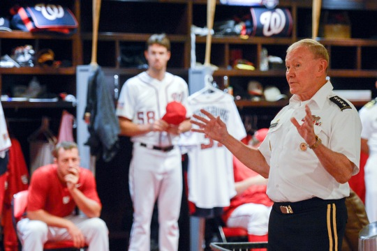 Chairman of the Joint Chiefs of Staff Gen. Martin E. Dempsey talks with players for the Washington Nationals Major League Baseball team before their game against the San Fransisco Giants at Nationals Stadium in Washington D. C., July, 4, 2015. (DoD photo by Mass Communication Specialist 1st Class Daniel Hinton)