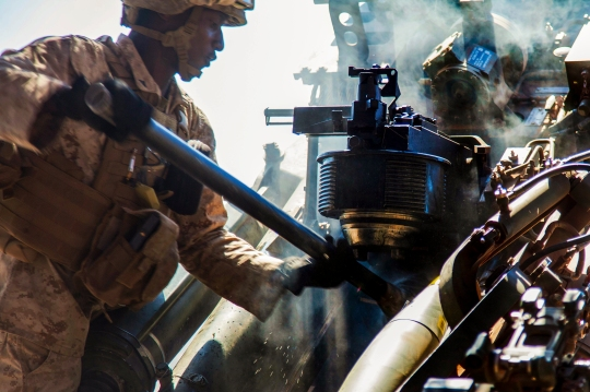 U.S. Marine Corps Lance Cpl. Marvin Henry, a Clarndon, Jamaica native, cleans the breach of an M777A2 lightweight 155 mm howitzer after firing a projectile in support of an air assault course June 29 at Bradshaw Field Training Area, Northern Territory, Australia. The AAC was a bilateral combined arms training event that combined light infantry, indirect fire weapons systems and air assets to capture and fight through a mock enemy objective. The concept of a rotational MAGTF is a cost-effective way to expose U.S.-based Marine units to various training environments while maintaining military partnerships with the Australian Defence Force and regional partners throughout Southeast Asia. Henry is an artilleryman with 3rd Battalion, 11th Marine Regiment, currently assigned to 3rd Battalion, 12th Marine regiment under the unit deployment program. (U.S. Marine Corps photo by SSgt. Jose O. Nava/Released)