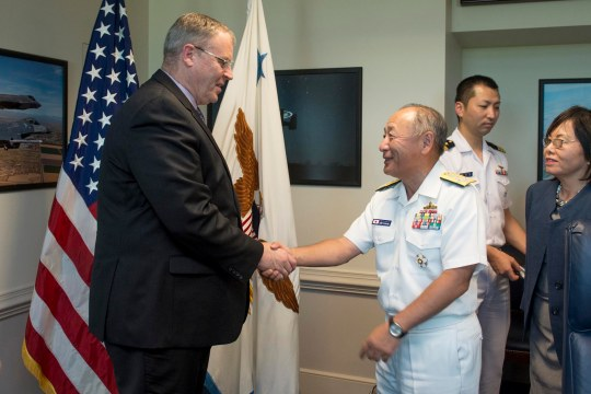 U.S. Deputy Defense Secretary Bob Work, left, greets Japanese Adm. Katsutoshi Kawano, chief of the joint staff for Japan Self-Defense Forces, as he arrives at the Pentagon, July 16, 2015. The two leaders met to discuss matters of mutual importance.