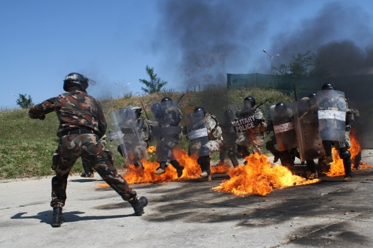 Soldiers with A Company, 1st Combined Arms Battalion, 252nd Armor Regiment, part of the Multinational Battle Group-East Forward Command Post, conduct fire phobia training July 15, 2015, at Camp Slim Lines in Pristina, Kosovo. The training, held to ensure MNBG-E troops are prepared to respond to situations that threaten a safe and secure Kosovo, was led by Hungarian army soldiers that are part of Kosovo Force Tactical Reserve Maneuver Battalion. (U.S. Army photo by Ardian Nrecaj, Multinational Battle Group-East)
