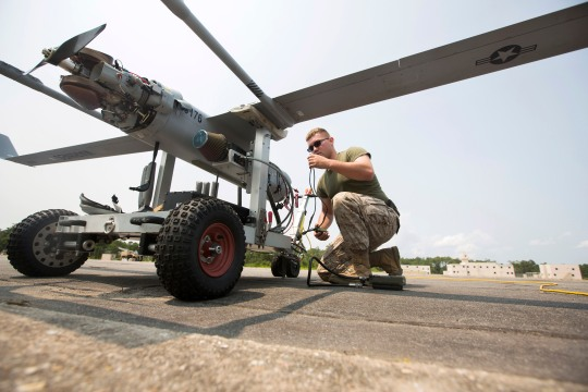 U.S. Marine Corps Lance Cpl. Mark W. Freas, an unmanned aerial vehicle maintainer assigned to Marine Unmanned Aerial Vehicle Squadron 2, performs a preflight check on an RQ-21A Blackjack prior to a training flight at Marine Corps Outlying Field Atlantic Field on July 1, 2015. The training flight was conducted to ensure the safety and stability of the small unmanned aircraft system. (U.S. Marine Corps photo by Lance Cpl. Koby I. Saunders/Released)