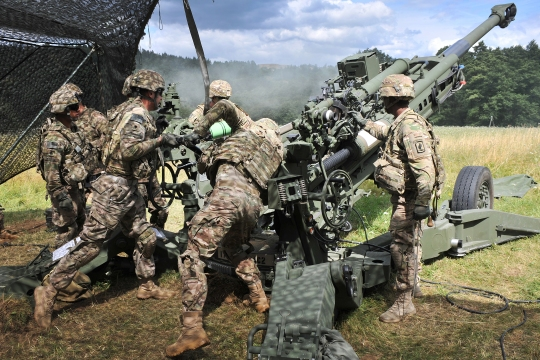 U.S. paratroopers with C Battery, 4th Battalion, 319th Airborne Field Artillery Regiment, 173rd Airborne Brigade, load a M119A2 howitzer in support of the British army's 1st Battalion, Royal Irish Regiment during exercise Wessex Storm at the 7th Army Joint Multinational Training Command's Grafenwoehr Training Area, Germany, July 28, 2015. (U.S. Army photo by Visual Information Specialist Gertrud Zach/released)