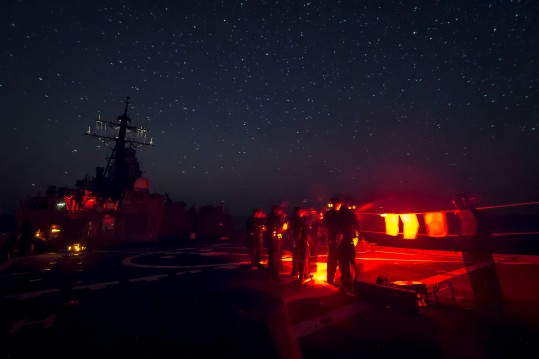 150708-N-FQ994-105  MEDITERRANEAN SEA (July 8, 2015)  Sailors aboard the guided-missile destroyer USS Ross (DDG 71) participate in a low-light small arms training exercise. Ross is conducting naval operations in the U.S. 6th Fleet area of operations in support of U.S. national security interests in Europe. (U.S. Navy photo by Mass Communication Specialist 3rd Class Robert S. Price/Released)