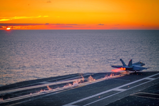150710-N-DV340-024  PACIFIC OCEAN (July 10, 2015) An F/A-18E Super Hornet assigned to the Kestrels of Strike Fighter Squadron (VFA) 137 launches at sunset from the flight deck of the aircraft carrier USS Ronald Reagan (CVN 76). Ronald Reagan is underway off the coast of Southern California. (U.S. Navy photo by Mass Communication Specialist 2nd Class Chase C. Lacombe/Released)