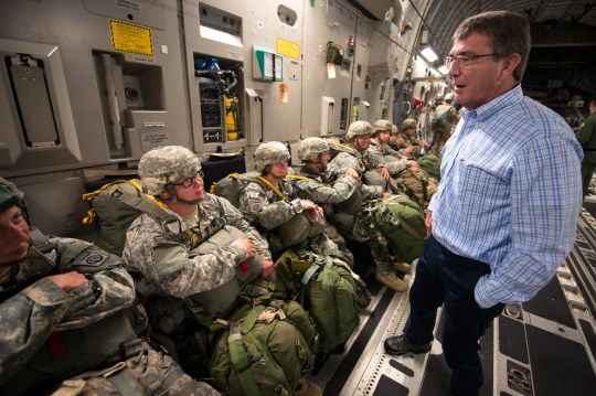 Secretary of Defense Ash Carter speaks with paratroopers of the 2nd Brigade Combat Team, 82nd Airborne Division as they prepare to jump over Sicily Drop Zone at Fort Bragg, N.C., July 10. These paratroopers form the nucleus of America's global response force, capable of responding to crises worldwide with little to no notice. Carter's visit included a question and answer session with Soldiers of the XVIII Airborne Corps and capabilities demonstrations from airborne and special operations forces. Carter praised the readiness of the servicemen and women stationed at Bragg, promising a bright future as the very tip of the spear in the nation's global strategic posture. (U.S. Army Photo by Staff Sgt. Charles Crail, XVIII Airborne Corps /Released)