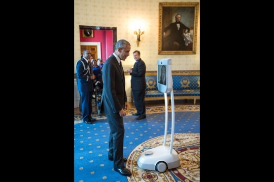 President Barack Obama greets Alice Wong, Disability Visibility Project Founder and Project Coordinator via robot during the Americans with Disabilities Act 25th Anniversary reception in the Blue Room of the White House, July 20, 2015. (Official White House Photo by Pete Souza)