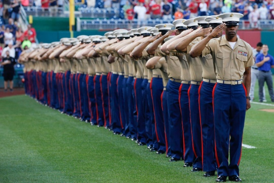 Marines from the National Capitol Region stand at attention during the playing of the National Anthem July 21, 2015, at Nationals Park in Washington. The Washington Nationals hosted a Marine Corps Day to honor Marines who serve and who have served in the past.