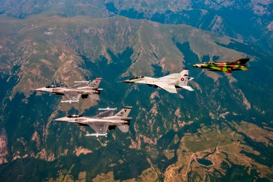 Two U.S. Air Force F-16 Fighting Falcons, from the New Jersey Air National Guard's 177th Fighter Wing, left, lead a mixed formation including a Bulgarian air force MiG-29 Fulcrum and MiG-21 Fishbed over Bulgaria during Thracian Star on July 20, 2015. Thracian Star 2015 is a bilateral training exercise to enhance interoperability with the Bulgarian air force, hosted by Graf Ignatievo Air Base. (U.S. Air National Guard photo by Master Sgt. Andrew J. Moseley/Released)