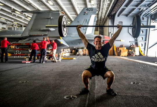 150729-N-MJ645-193 PACIFIC OCEAN (July 29, 2015) -- Electrician's Mate Fireman Christopher Appel, a native of Barberton, Ohio, exercises in the hangar bay aboard USS John C. Stennis (CVN 74). The Sailors from the John C. Stennis Strike Group are undergoing the Composite Training Unit Exercise (COMPTUEX), the final step before being certified for deployment. (U.S. Navy photo by Mass Communication Specialist 2nd Class Marcus L. Stanley/Released)