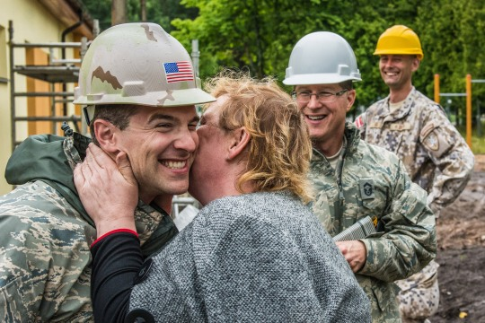 U.S. Air Force Capt. Joseph Morrey (left), with the 139th Civil Engineering Squadron, Missouri Air National Guard, is kissed on the cheek for thanks by Lilita Gasjaneca, director of the Naujenu Orphanage, during the reconstruction of the Naujenu Orphanage near Daugavpils, Latvia, July 20, 2015. The 139th CE was participating in the Humanitarian Civic Assistance project that pairs unit's trainings requirements with humanitarian needs. (U.S. Air National Guard photo by Senior Airman Patrick P. Evenson/Released)
