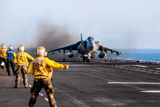 U.S. Navy Aviation Boatswain's Mates give the thumbs-up signal to take off to an AV-8 Harrier assigned to Marine Attack Squadron 311, 31st Marine Expeditionary Unit, during exercise Talisman Sabre 2015 aboard the USS Bonhomme Richard Expeditionary (LHD 6), at sea, Australia, July 11, 2015. Talisman Sabre is a major bilateral exercise that demonstrates the strong Australian-U.S. alliance and military relationship. (U.S. Marine Corps photo by GySgt Ismael Pena/released)