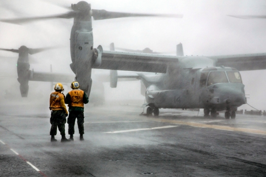 150804-N-RL456-448  ATLANTIC OCEAN (Aug. 4, 2015) Sailors prepare for flight operations on the flight deck of the amphibious assault ship USS Kearsarge (LHD 3). The Kearsarge Amphibious Ready Group and the 26th Marine Expeditionary Unit (26th MEU) are conducting a composite training unit exercise in preparation for an upcoming deployment. (U.S. Navy photo by Mass Communication Specialist 2nd Class Hunter S. Harwell/Released)
