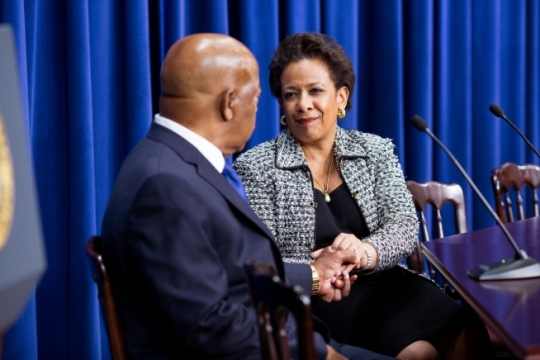 Attorney General Loretta Lynch clasps hands with Rep. John Lewis, D-Ga., as President Barack Obama recognizes them during his remarks to commemorate the 50th anniversary of the Voting Rights Act, in the Eisenhower Executive Office Building South Court Auditorium, Aug. 6, 2015. (Official White House Photo by Pete Souza)