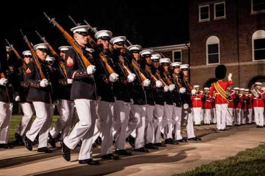Marines march during an evening parade at Marine Barracks Washington in Washington, D.C., July 31, 2015. Army Gen. Martin E. Dempsey, chairman of the Joint Chiefs of Staff, was the parade's guest of honor, and Marine Corps Commandant Gen. Joseph F. Dunford Jr., confirmed by the Senate as the next Joint Chiefs chairman, hosted the event.