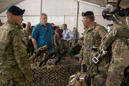 Deputy Secretary of Defense Bob Work speaks with Army Special Forces members  as they display some of their equipment at the Army National Training Center in Fort Irwin, Calif., Aug. 5, 2015. Work was in attendance to observe a live fire training exercise. (Photo by Master Sgt. Adrian Cadiz)(Released)