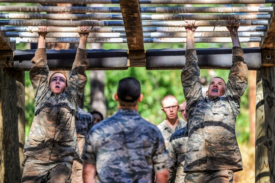 "Basic cadets navigate the monkey bars on the obstacle course in the U.S. Air Force Academy's Jacks Valley during the field portion of their Basis Cadet Training July 22, 2015, in Colorado Springs, Colo.  ""Second Beast"" is the second half of Basic Cadet training which began with inprocessing June 25, 2015. (U.S. Air Force Photo/Liz Copan/released)"
