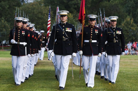 Marines execute a pass and review during a sunset parade at the Marine Corps War Memorial in Arlington, Va., July 28, 2015. Navy Adm. Harry B. Harris, commander of U.S. Pacific Command, was the parade's guest of honor. The Marines are assigned to Marine Barracks Washington.