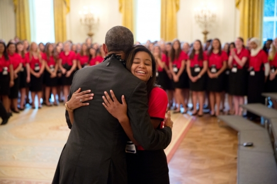 President Barack Obama gets a hug from Johnsenia Brooks after a group photo with American Legion Girls Nation delegates in the East Room of the White House, July 30, 2015. (Official White House Photo by Pete Souza)