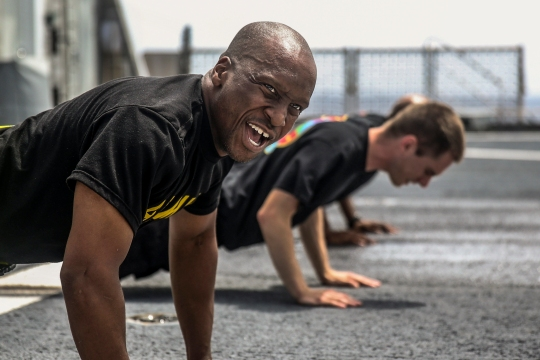 150729-M-GO800-063 PACIFIC OCEAN (July 29, 2015) – U.S. Army Sgt. Jonathon Bailey shouts instructions while performing push-ups aboard the Military Sealift Command joint high speed vessel USNS Millinocket (JHSV 3) during a physical training session designed to help with stress management July 29. Task Force Forager, embarked aboard the Millinocket is serving as the secondary platform for Pacific Partnership, led by an expeditionary command element from the Navy's 30th Naval Construction Regiment (30 NCR) from Port Hueneme, Calif. Now in its 10th iteration, Pacific Partnership is the largest annual multilateral humanitarian assistance and disaster relief preparedness mission conducted in the Indo-Asia Pacific region. While training for crisis conditions, Pacific Partnership, missions have provided medical care to approximately 270,000 patients and veterinary service to more than 38,000 animals. Additionally, Pacific Partnership has provided critical infrastructure development to host nations through the completion of more than 180 engineering products. (U.S. Marine Corps photo by combat correspondent Sgt. James Gulliver/Released)