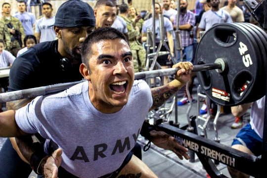 A U.S. soldier participates in the squat event during the weightlifting competition at the Rock Fitness Center on Bagram Airfield, Afghanistan, July 18, 2015.The service members competed in the squat, deadlift and bench press events during the weightlifting competition.