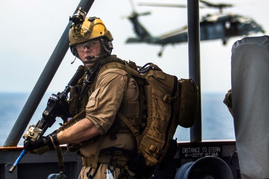 A U.S. Marine assigned to Force Reconnaissance Platoon, Maritime Raid Force, 26th Marine Expeditionary Unit (MEU), provides security for his team while conducting a joint Visit, Board, Search, and Seizure (VBSS) exercise alongside Navy SEALs, during composite training unit exercise (COMPTUEX) in the Atlantic Ocean, July 20, 2015. Marines with the 26th MEU and Sailors with the Kearsarge Amphibious Ready Group are participating in COMPUTEX in preparation for their deployment to the 5th and 6th Fleet areas of responsibility later this fall. A U.S. Marine assigned to Force Reconnaissance Platoon, Maritime Raid Force, 26th Marine Expeditionary Unit (MEU), provides security for his team while conducting a joint Visit, Board, Search, and Seizure (VBSS) exercise alongside Navy SEALs, during composite training unit exercise (COMPTUEX) in the Atlantic Ocean, July 20, 2015.. Marines with the 26th MEU and Sailors with the Kearsarge Amphibious Ready Group are participating in COMPUTEX in preparation for their deployment to the 5th and 6th Fleet areas of responsibility later this fall. (U.S. Marine Corps photo by Cpl. Andre Dakis/26th MEU Combat Camera/Released)