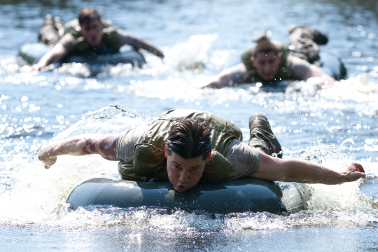 U.S. Army Sgt. David Pileggi, a Soldier with P Troop, 4th Squadron, 2nd Cavalry Regiment, paddles across a lake Aug. 6, 2015, at the Nowa Deba Training Area in Poland. The Soldiers are completing a water obstacle course created by Polish soldiers from the 6th Airborne Brigade. The training is part of Operation Atlantic Resolve, an ongoing multinational partnership focused on combined training and security cooperation between NATO allies. Led by the mission command element of the 4th Infantry Division and in conjunction with European partner nations, Atlantic Resolve is intended to improve combined operational capability in a range of missions and ensure the continued peace and stability of Europe. (U.S. Army photo by Spc. Marcus Floyd, 7th Mobile Public Affairs Detachment)