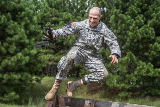 Army Staff Sgt. Russell Vidler leaps over the wall at the Fit to Win obstacle course on Fort Jackson, S.C., Sept. 9, 2015. Vidler, a Reserve drill sergeant assigned to the 98th Training Division, was in a head-to-head competition for the title of Army Reserve's top drill sergeant. U.S. Army photo by Sgt. 1st Class Brian Hamilton