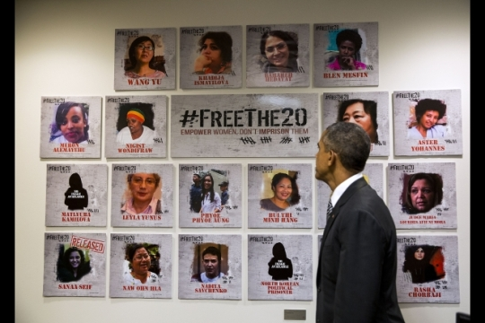 President Barack Obama looks at a display outside the office of Amb. Samantha Power, U.S. Permanent Representative to the United Nations, at the United States Mission to the United Nations in New York, N.Y. Sept. 27, 2015. The display refers to a campaign launched by Amb. Power Sept. 1 that raises awareness and highlights cases of twenty women political prisoners and other prisoners of concern from around the world, and calls for their release. (Official White House Photo by Pete Souza)