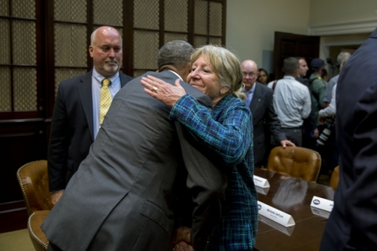 President Barack Obama hugs Gold Star mother Michelle DeFord following a roundtable with veterans and Gold Star mothers regarding the Iran nuclear agreement, in the Roosevelt Room of the White House, Sept. 10, 2015. Secretary of State John Kerry also participated. (Official White House Photo by Pete Souza)