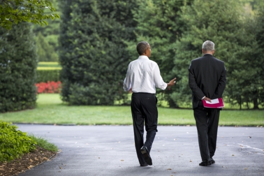 President Barack Obama walks with Chief of Staff Denis McDonough on the South Lawn driveway of the White House, Sept. 3, 2015. (Official White House Photo by Pete Souza)