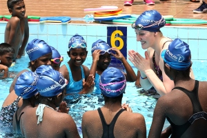SEENIGAMA, SRI LANKA-OCTOBER 6, 2015:  Laureus Ambassador and Olympic gold medalist Missy Franklin greets end of Sri Lankan young swimmers training session during the Missy Franklin Sri Lanka Project Visit at Sport Academy Swimming Pool of Foundation of Goodness on October 6, 2015 in Seenegama, Sri Lanka. (Photo by Buddhika Weerasinghe/Laureus/Getty Images)