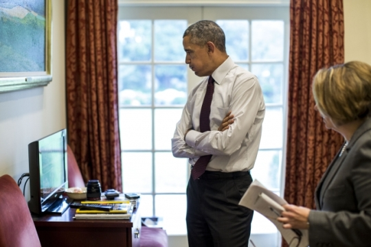 President Barack Obama, with Homeland Security Advisor Lisa Monaco, reacts while glancing at cable TV coverage of the mass shooting at Umpqua Community College in Roseburg, Ore., in the Outer Oval Office, Oct. 1, 2015. (Official White House Photo by Pete Souza)
