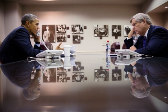 "President Barack Obama and Agriculture Secretary Tom Vilsack participate in a phone interview with Tom Steever, host of radio show ""Brownfield Ag News,"" at the U.S. Department of Agriculture in Washington, D.C., Oct. 6, 2015. (Official White House Photo by Pete Souza)"