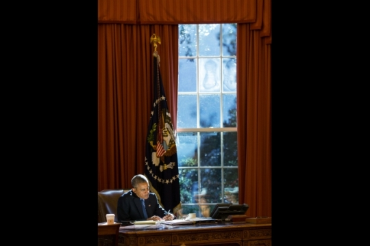 President Barack Obama works at the Resolute Desk in the Oval Office, Oct. 23, 2015. (Official White House Photo by Pete Souza)