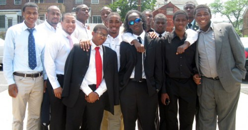Two Black male teachers with a group of male students at Dunbar High School in Washington, DC - the first public high school for African Americans  Photo Courtesy:  Blacknews.com