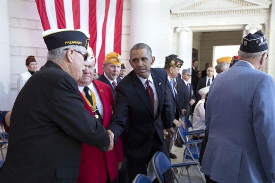 President Barack Obama greets veterans and guests at the conclusion of the Veterans Day ceremony at the Memorial Amphitheater at Arlington National Cemetery in Arlington, Va., Nov. 11, 2015. (Official White House Photo by Pete Souza)