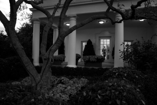 President Barack Obama walks through the Oval Office as seen from the Rose Garden of the White House, Nov. 4, 2015. (Official White House Photo by Pete Souza)